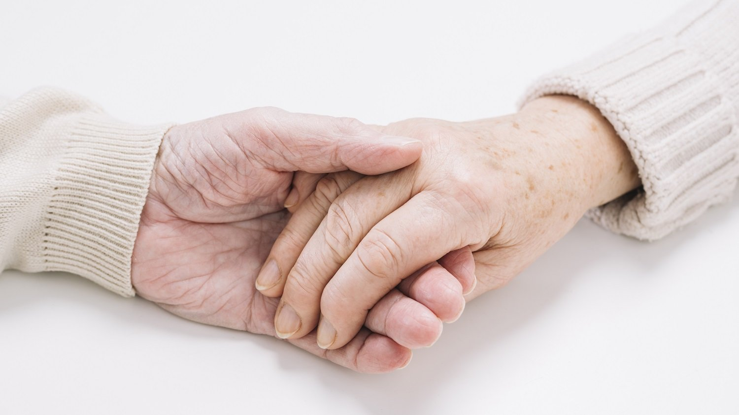 older couple holding hands Alzheimers support
