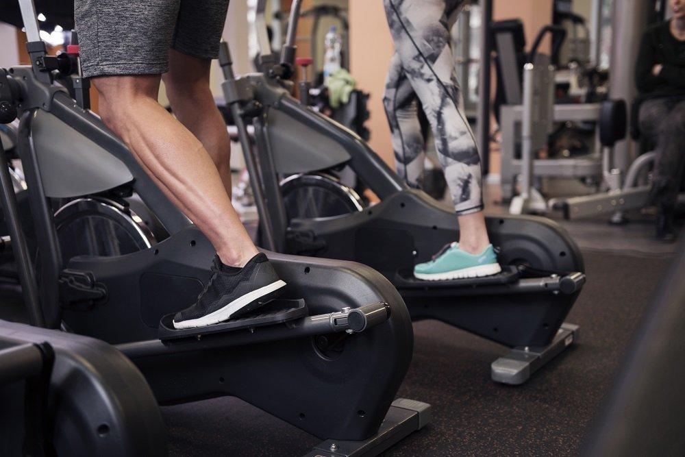 man and woman exercising at curtis wellness center