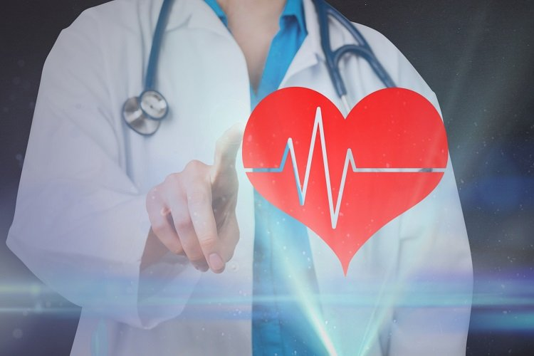 doctor and heart with cardiac monitor