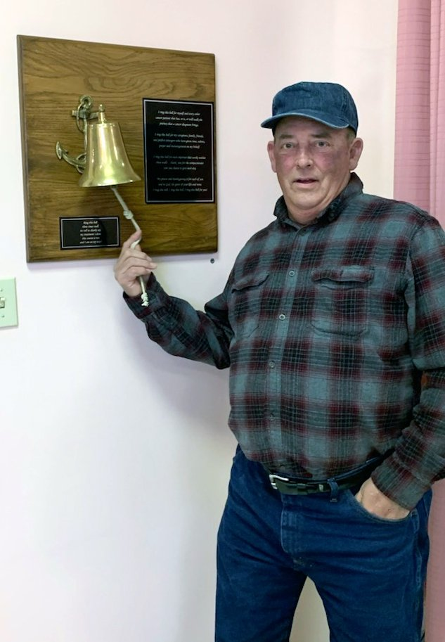 a patient rings the bell after completing his last chemotherapy treatment