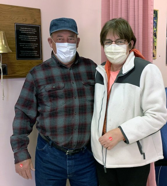 Jim & Jean Foley stand next to the bell they donated for Chemo patients