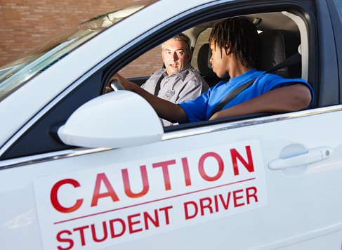 taking a driving course with a teacher