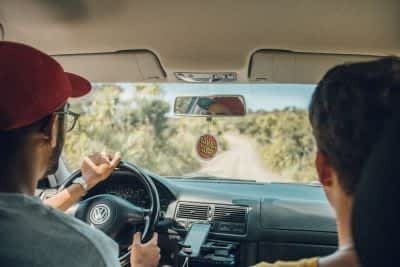 teens driving in car