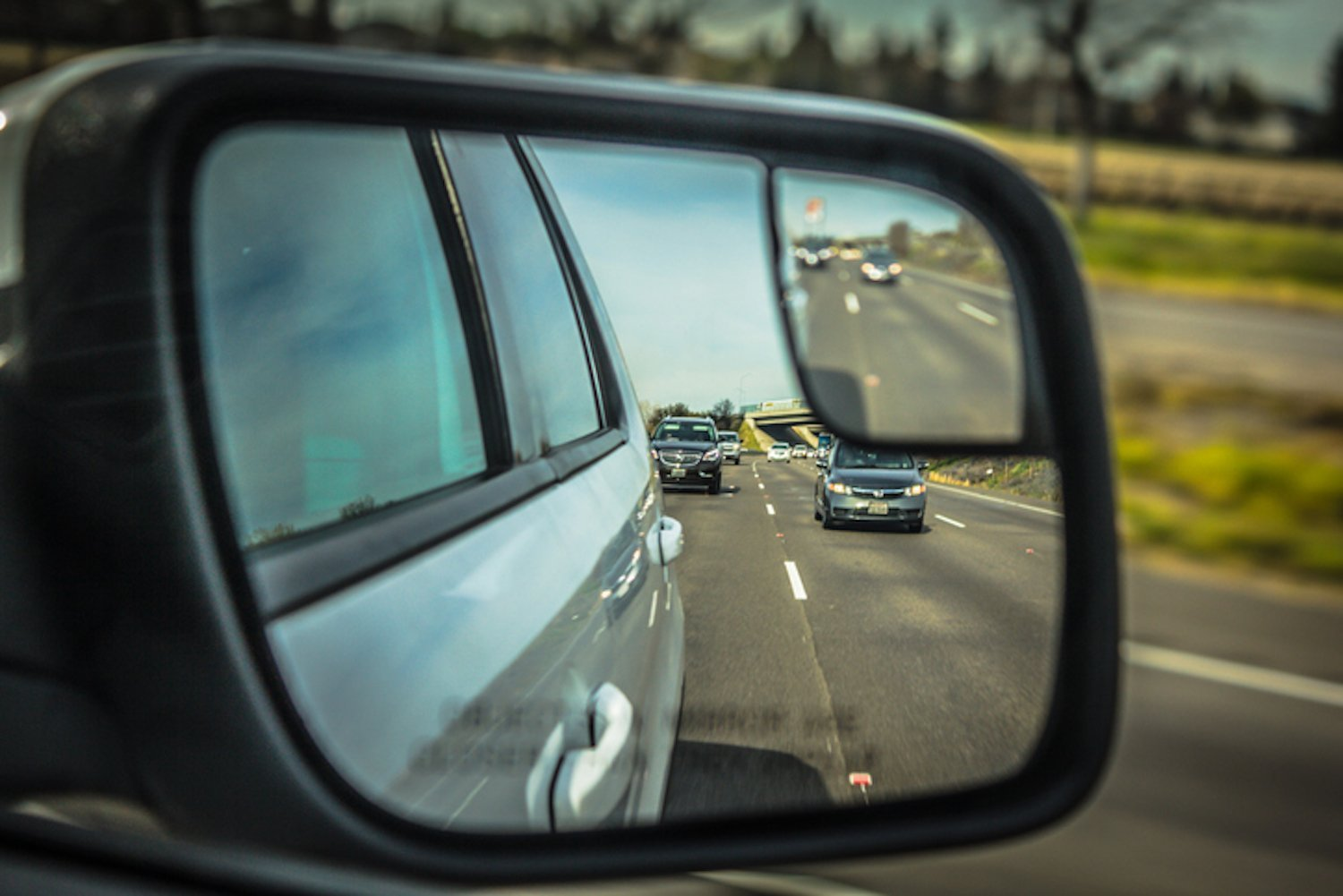 checking rearview mirror