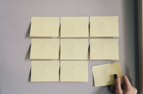 Teacher being organized with sticky notes