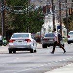 jaywalking male pedestrian