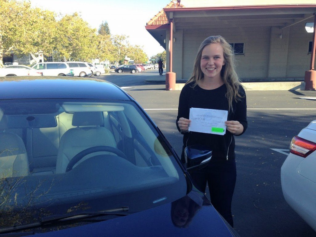 DriversEd.com contributing writer Amy Tarczynski posing with her paperwork as she was getting her license.