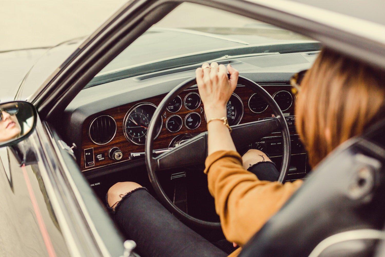 woman driving old car in california