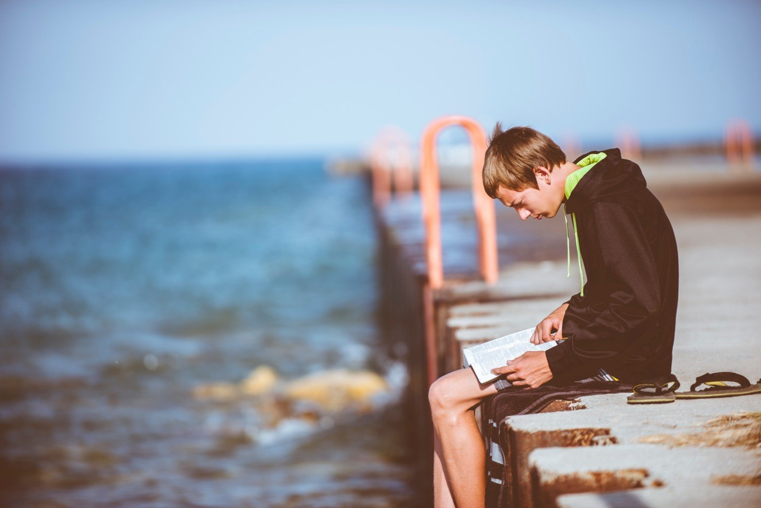 boy-reading-on-pier.jpg
